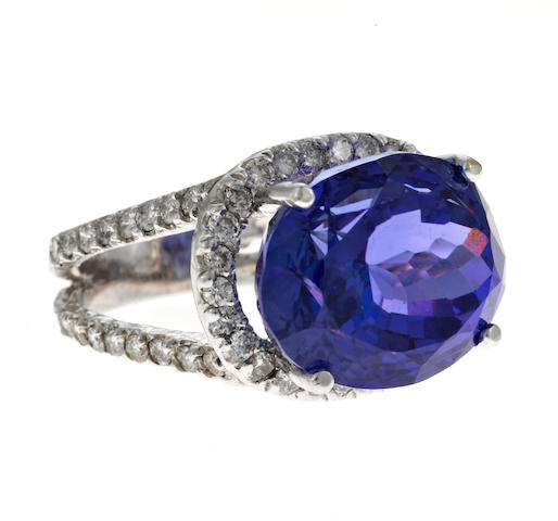 A tanzanite, diamond and 14k white gold ring