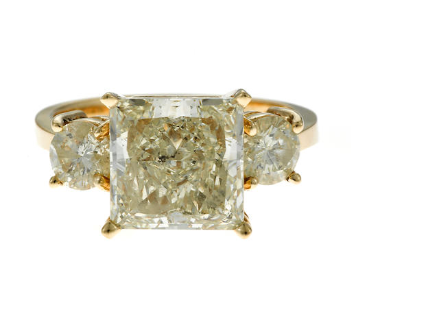 A princess-cut, round brilliant-cut diamond and gold ring