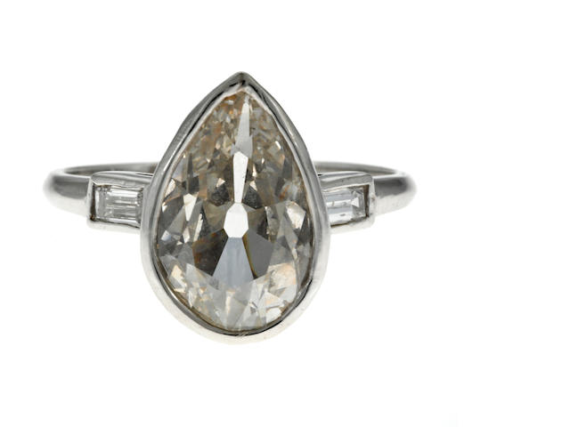A pear-shape diamond and platinum ring