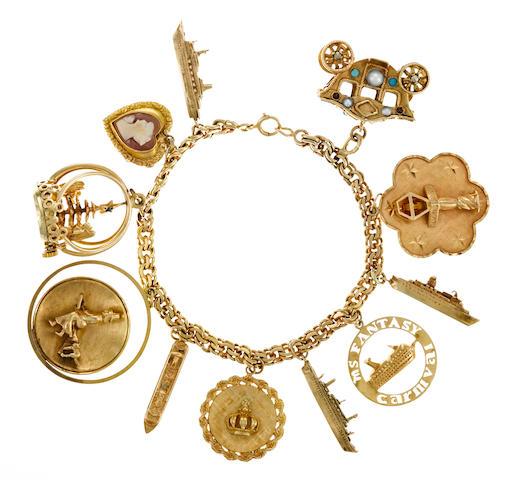 A fourteen karat gold charm bracelet
