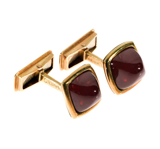 A pair of 18k gold and garnet cabochon cufflinks, Grima