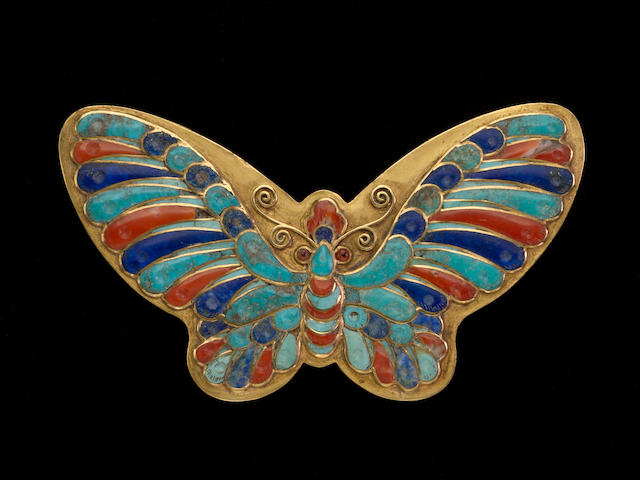 A gold butterfly box with enamel detail studio mark