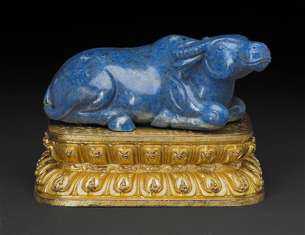 A carved lapis lazuli buffalo with gilt-bronze stand