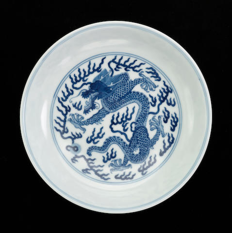 A blue and white dragon dish Jiaging mark and period