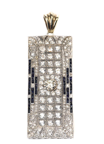 A diamond, sapphire and platinum/metal pendant