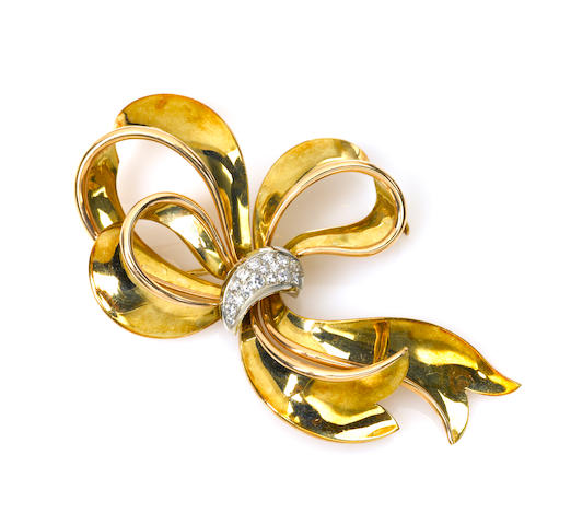 "A diamond and eighteen karat gold ""bow"" brooch"