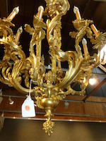 A fine Louis XV style gilt bronze twelve light chandelier <BR />late 19th century