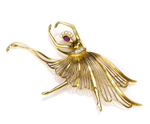 "A ruby, diamond, 18k gold and platinum ""dancer"" brooch"