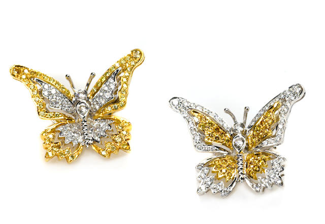 A pair of colored diamond, diamond and 18k bicolor gold butterfly brooches