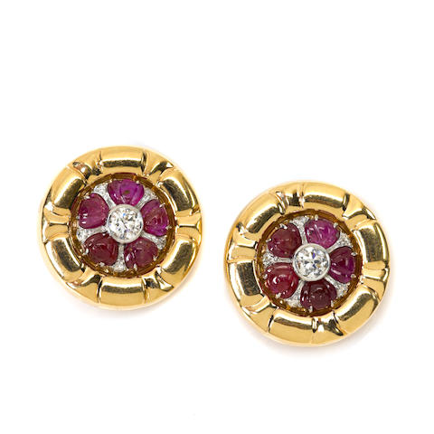 A pair of ruby, diamond and 14k gold disc earclips