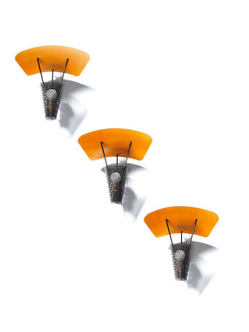 Pierre Guariche A Set of Three Wall Lights circa 1955  pierced and enamelled metal  Height: 12 13/16 in. 31 cm.