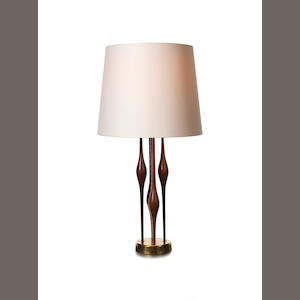 A Table Lamp circa 1960  teak and brass  Height: 40 3/8 in. 102.5 cm.