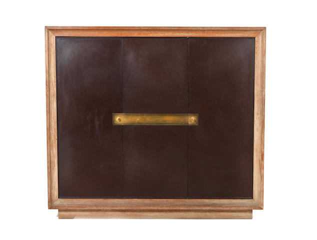 Jacques Adnet A Three Door cabinet circa 1935  limed oak, bronze and leather  66 15/16 x 75 9/16 x 21 5/8 in. 170 x 192 x 55 cm.