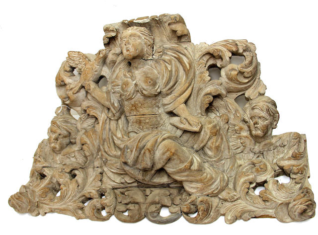 A pair of Baroque walnut overdoor figural panels emblematic of Justice and Liberty 18th century