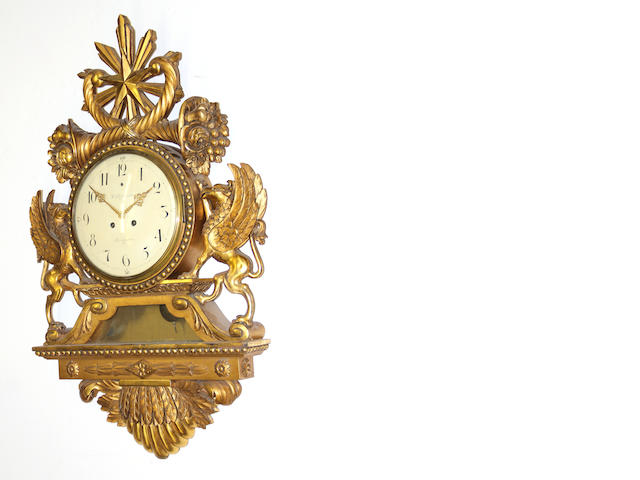 A Swedish Neoclassical style giltwood figural wall clock first half 20th century