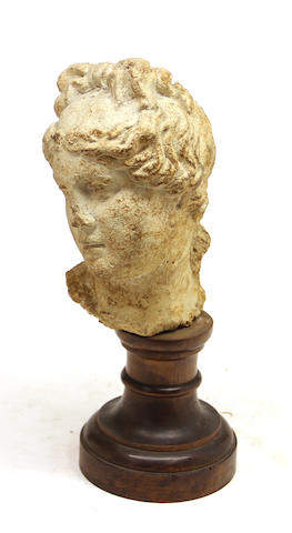 A Classical style cast stone head of a goddess 20th century