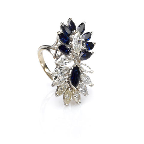 A sapphire, diamond and white metal cocktail ring