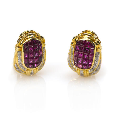 A pair of ruby, diamond and gold earrings