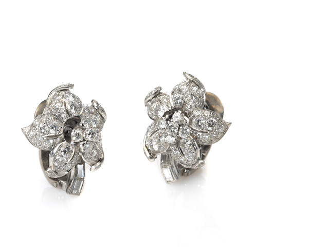 A pair of diamond and platinum flower earclips
