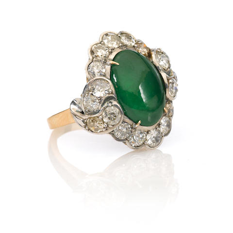 A cabochon jade, diamond and gold ring