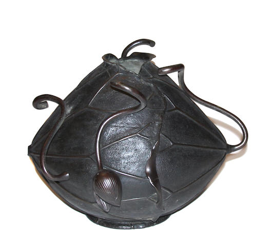 A Japanese bronze lotus form sculpture
