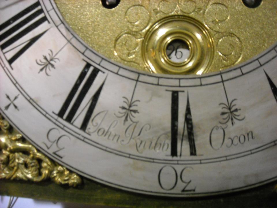 A Queen Anne walnut tall case clock first quarter 18th century