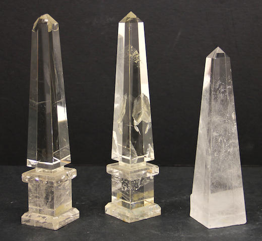 An assembled group of three rock crystal obelisks in various sizes