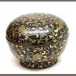 A Japanese black lacquer and gilt decorated circular box and cover