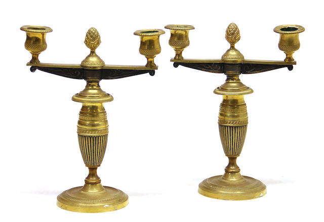 A pair of Empire style patinated and gilt-bronze two light candelabra 19th century