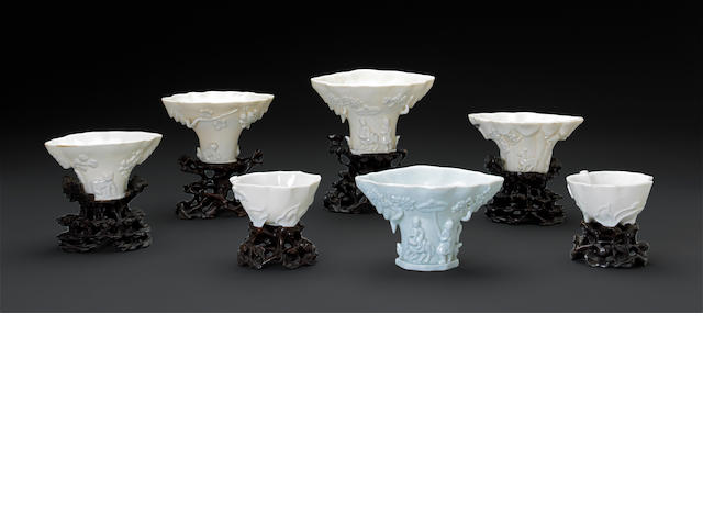 A group of seven blanc de chine libation cups, six with stands 18th century