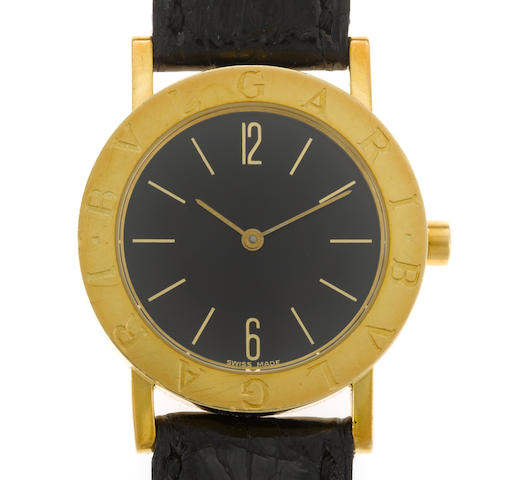 An eighteen karat gold and leather strap wristwatch, Bulgari
