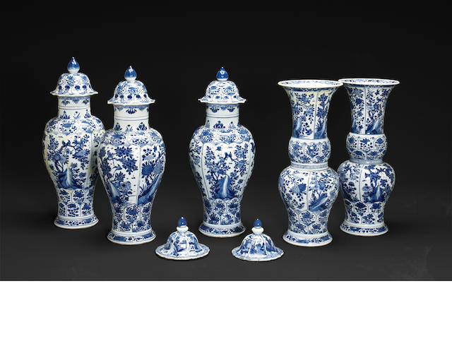 A Chinese five piece (possibly assembled) garniture set of blue and white porcelain, together with two additional associated lids  Kangxi period