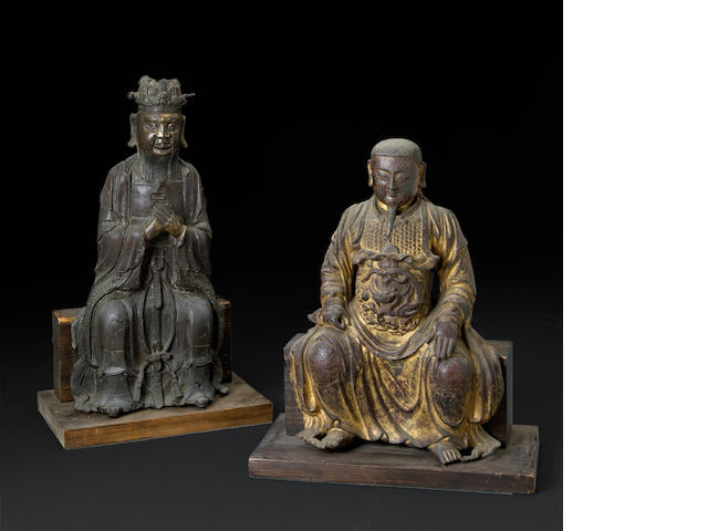 Two cast bronze seated Daoist divinities China, late Ming dynasty