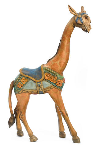A Contemporary carved and paint decorated giraffe