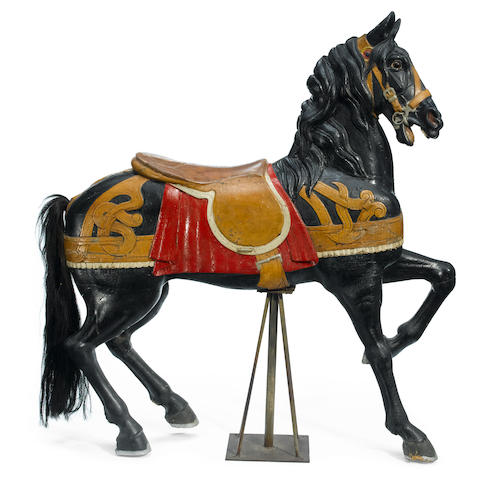A carved and paint decorated carousel horse <BR />Charles Muller and Gustav Dentzel,Philadelphia <BR />late 19th/early 20th century