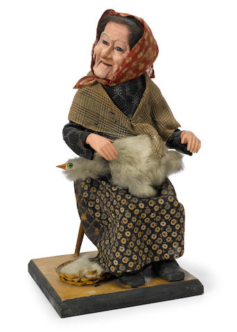 An Old Mother Hubbard automaton <BR />French, late 19th/early 20th century