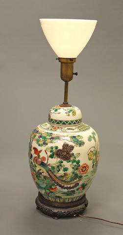 A famille verte enameled porcelain covered jar Qing dynasty Drilled and electrified as a table lamp.