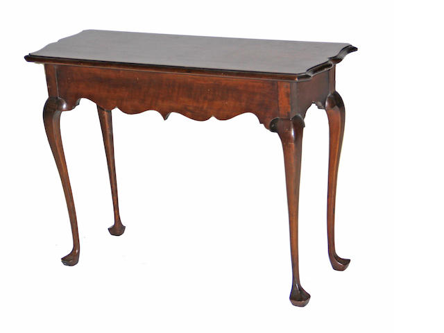 A George III style walnut table 20th century