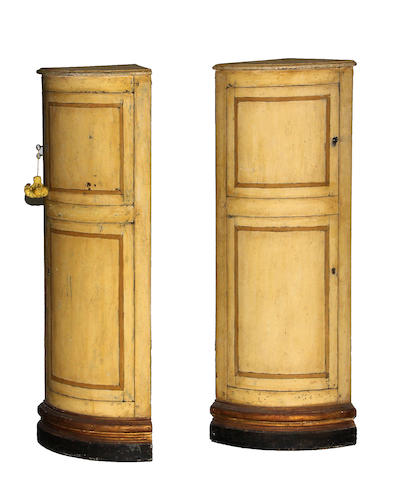 A pair of Italian Neoclassical painted corner cabinets late 19th century