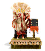 A clown with fan and magic box automaton <BR />French,late 19th/ early 20th century