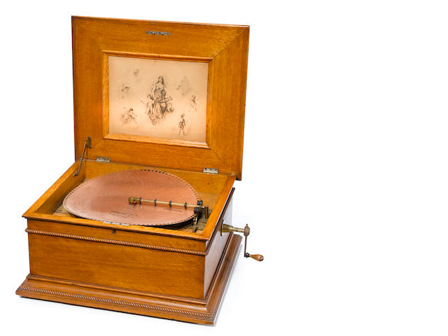"A Regina oak 15"" disc music box <BR />late 19th century"
