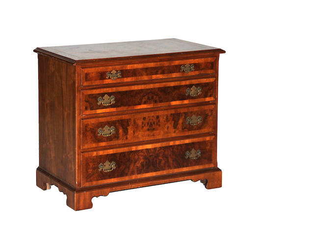A George III style walnut and burl walnut four drawer chest of drawers 20th century