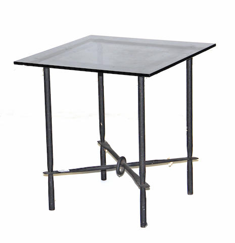 A patinated metal and glass side table