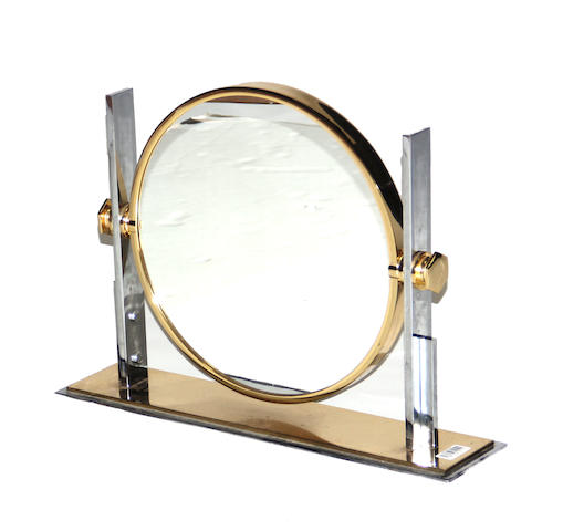 A deco style chromed metal and brass table mirror