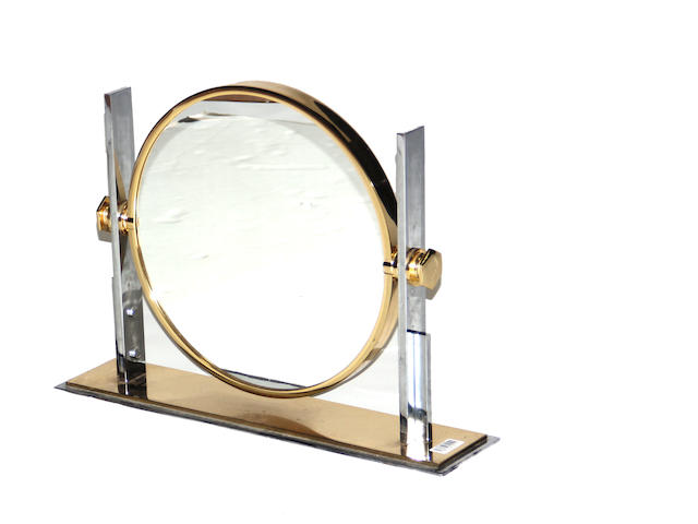 A chromed metal and brass table mirror