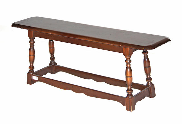 A Baroque style walnut low bench