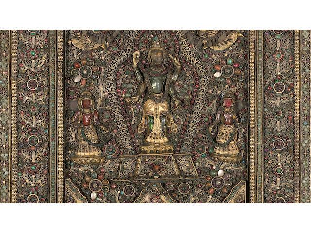 An inlaid gilt metal devotional plaque Nepal, Newari, 19th/20th Century