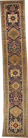 A Heriz runner Northwest Persia size approximately 3ft. 2in. x 17ft. 6in.