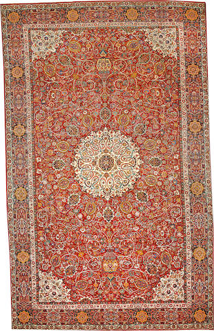 A Sarouk carpet  South Central Persia size approximately 11ft. 10in. x 19ft. 2in.