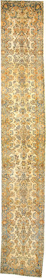 A Kerman runner  South Central Persia size approximately 2ft. 11in. x 18ft. 9in.